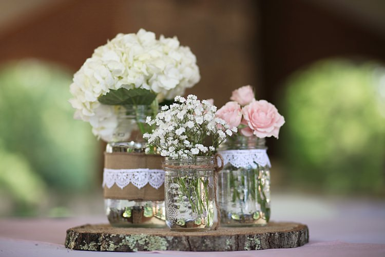 Floral Décor White Hydrangea Pink Roses Baby's Breath Glass Jars Burlap Lace Trim Round Wooden Tree Slice Soft Romantic Woodland Wedding Tennessee http://www.jessicaleephotographicart.com/