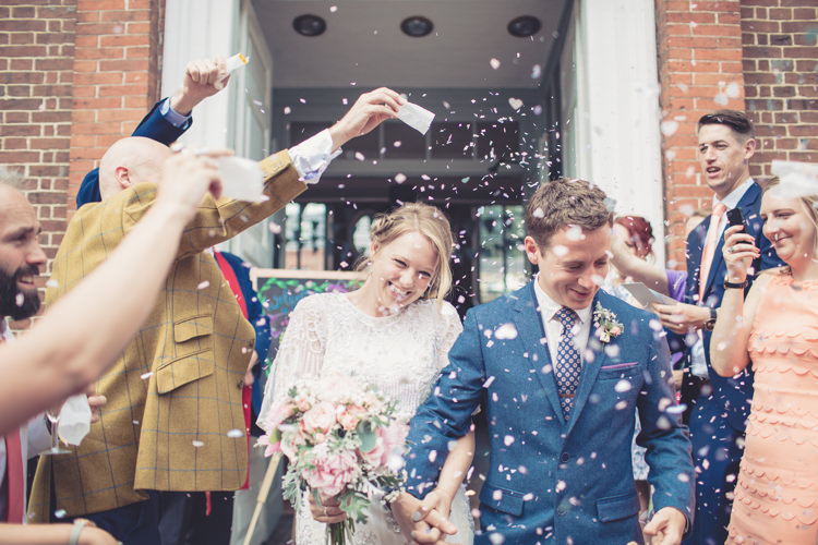 Confetti Throw Homespun Festival Village Hall Wedding http://www.himandherweddingphotography.co.uk/