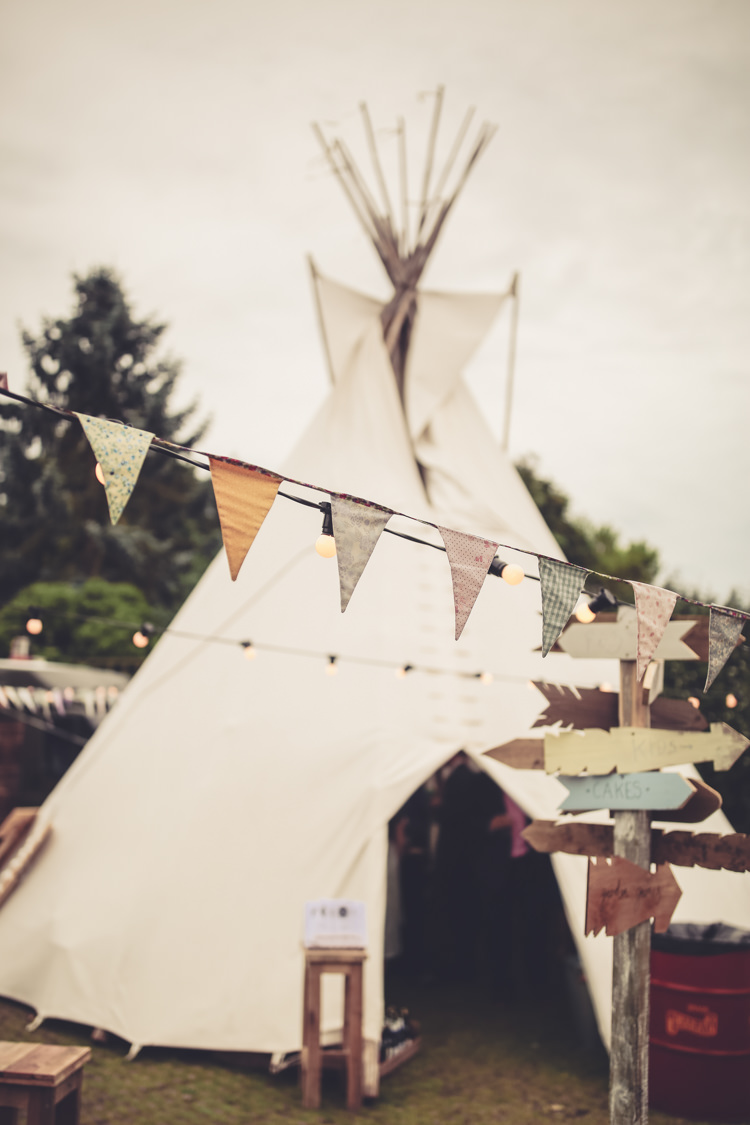 Tipi Bunting Sing Festoon Lights Homespun Festival Village Hall Wedding http://www.himandherweddingphotography.co.uk/