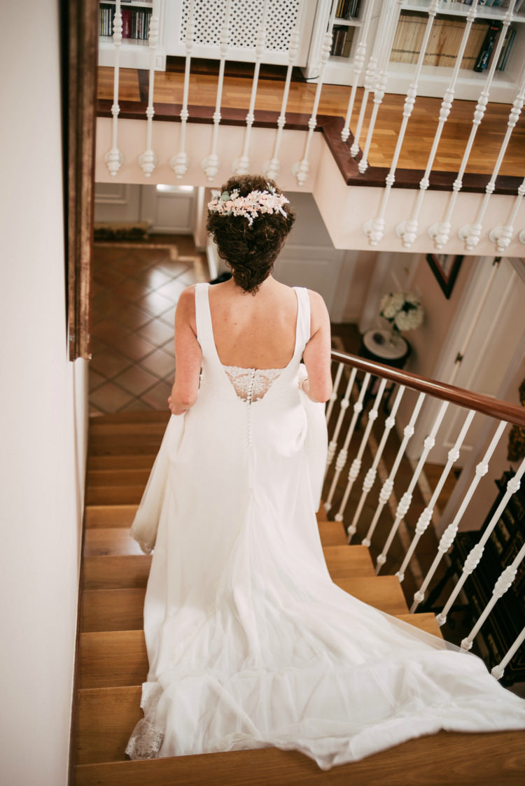 Bride Round Neck Low Back Crepe Tulle Bridal Gown Floral Hair Piece Staircase Romantic Bohemian Spain Wedding http://saralobla.com/