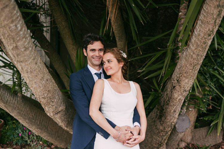 Bride Round Neck Crepe Tulle Bridal Gown Floral Hairpiece Groom Navy Blue Suit Grey Vest Polka Dot Tie Outdoors Palm Trees Romantic Bohemian Spain Wedding http://saralobla.com/