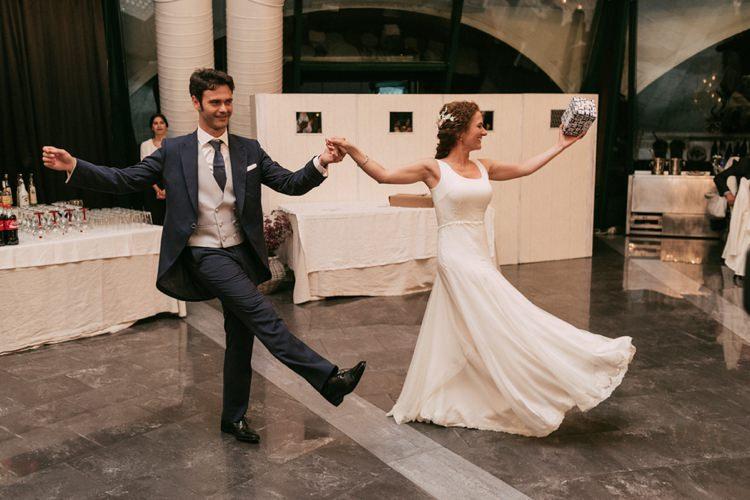Reception Bride Round Neck Crepe Tulle Bridal Gown Floral Hairpiece Groom Navy Suit Grey Vest Polka Dot Tie Dancing Romantic Bohemian Spain Wedding http://saralobla.com/