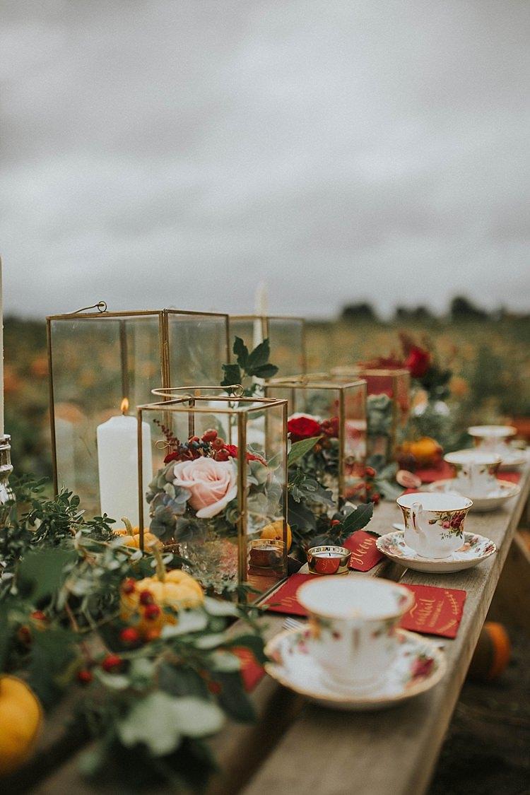 Table Scape Decor Rustic Red Gold Tea Cups Pumpkin Field Autumn Wedding Ideas http://www.jessicajweddingphotography.co.uk/