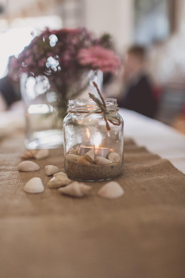 Jam Jar Candle Sand Shells Hessian Burlap Relaxed Seaside St Ives Wedding http://www.wearetheclarkes.com/