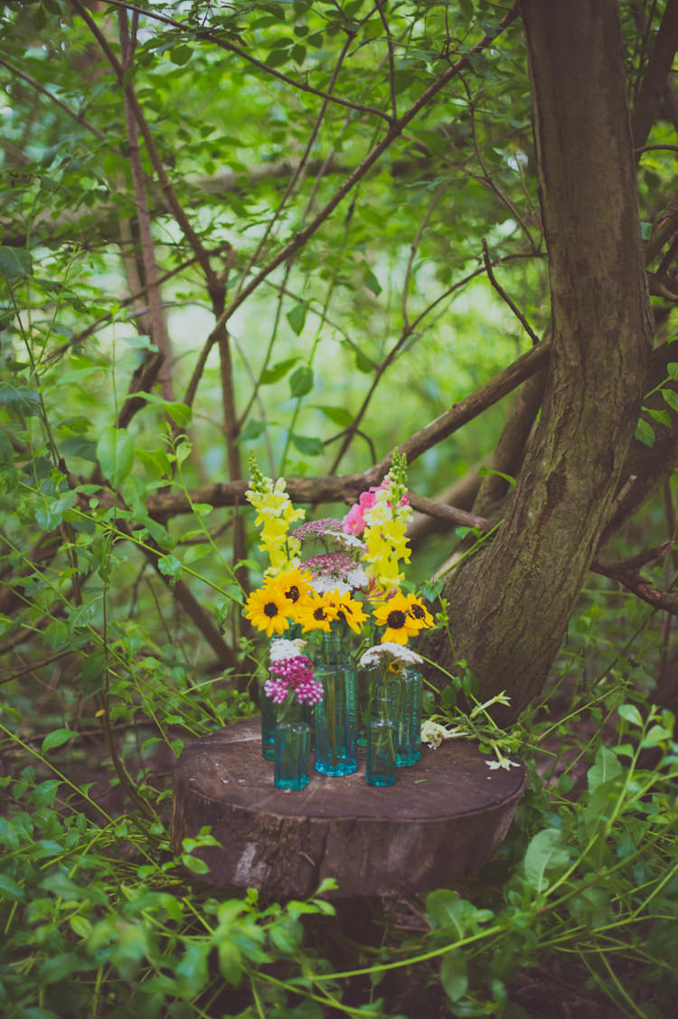 Bottle Flowers Log Slice Tree Stump Colourful Woodland Humanist Wedding http://sashaweddings.co.uk/