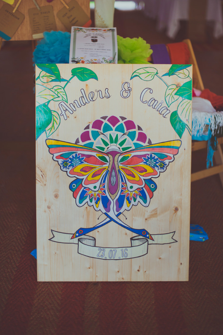 Painted Wooden Sign Colourful Woodland Humanist Wedding http://sashaweddings.co.uk/