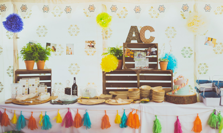 Tassels Crates Pom Poms Decor Colourful Woodland Humanist Wedding http://sashaweddings.co.uk/