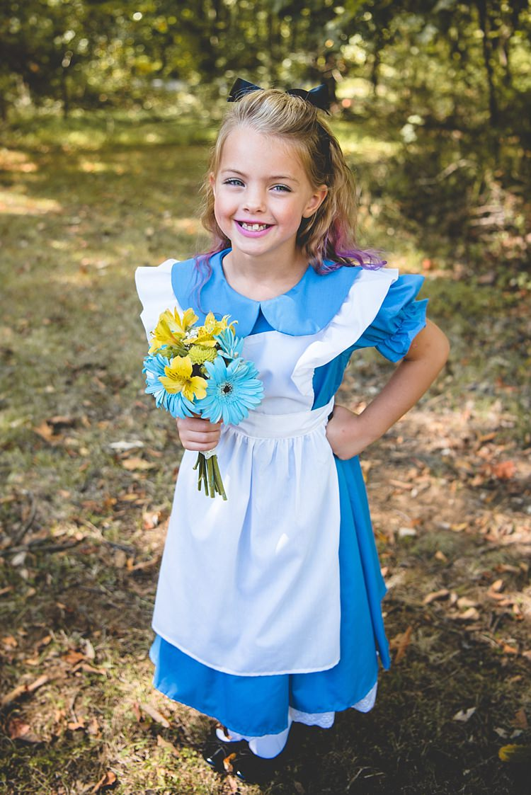 Flowergirl Alice Costume Pink Hair Highlights Black Bow Gerbera Yellow Blue Bouquet Alice in Wonderland Wedding Pennsylvania http://www.julieflorophotography.com/