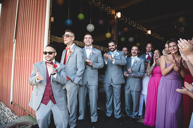 Groomsmen Grey Suits Multicoloured Vests Bowties Bridesmaids Colourful Dresses Bright Hanging Lanterns Fairy Lights Barn Alice in Wonderland Wedding Pennsylvania http://www.julieflorophotography.com/