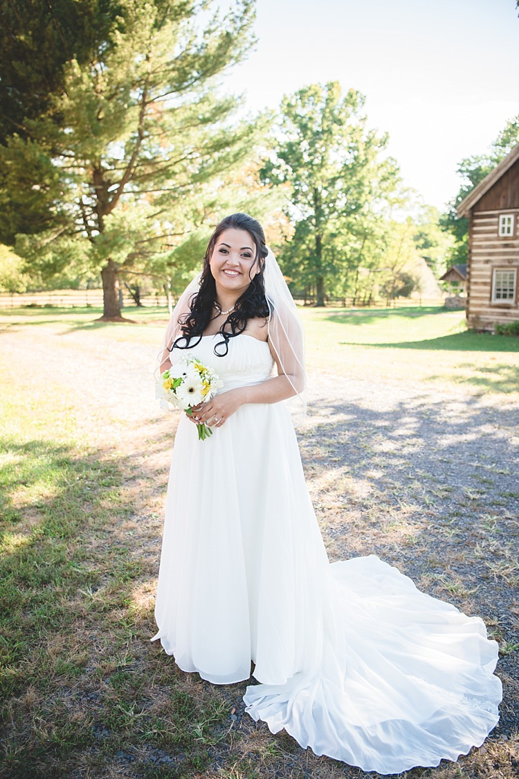 Bride Strapless Gown With Train Veil Soft Curls Hairstyle Bouquet White Yellow Gerbera Alice in Wonderland Wedding Pennsylvania http://www.julieflorophotography.com/