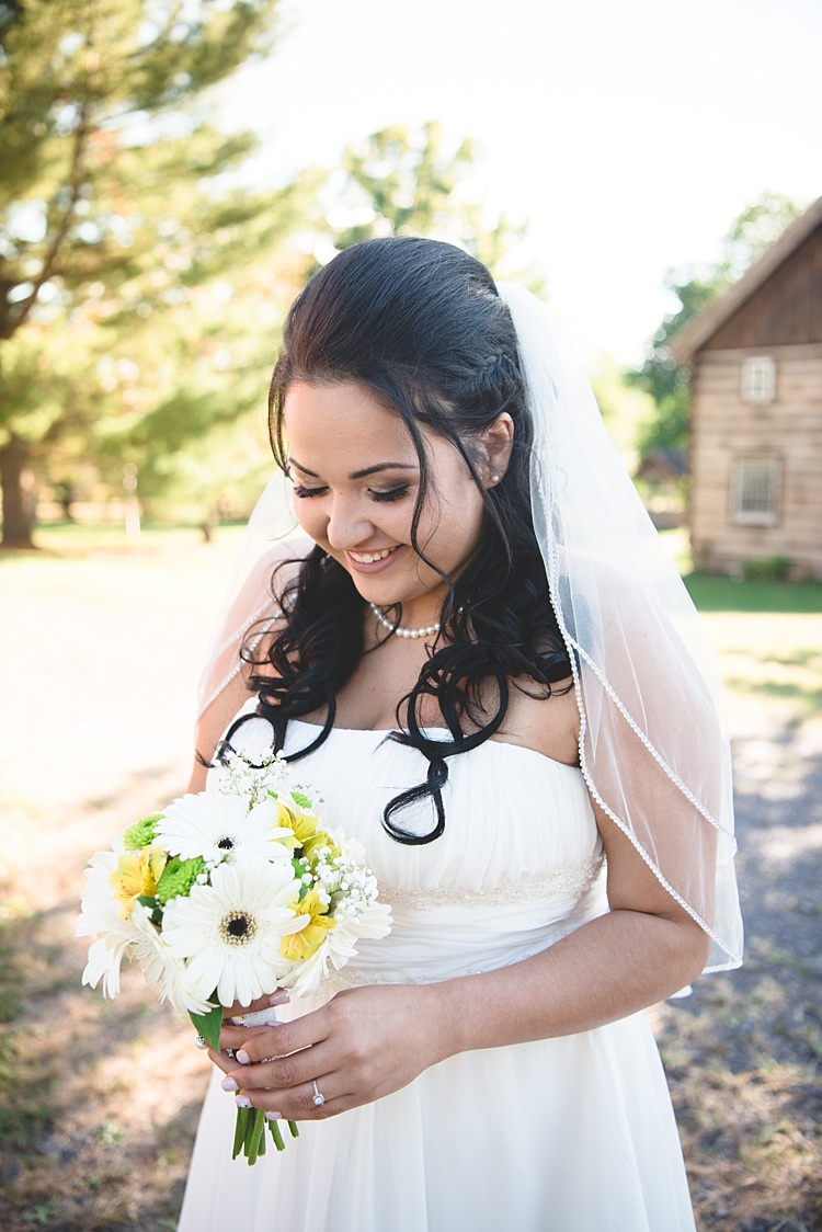 Bride Strapless Gown With Train Veil Soft Curls Hairstyle Pearl Necklace Bouquet White Yellow Gerbera Smiles Alice in Wonderland Wedding Pennsylvania http://www.julieflorophotography.com/
