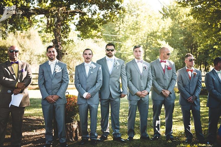 Outdoor Ceremony Groom Grey Suit White Bowtie Groomsmen Grey Suits Multicoloured Vests Bowties Celebrant Alice in Wonderland Wedding Pennsylvania http://www.julieflorophotography.com/
