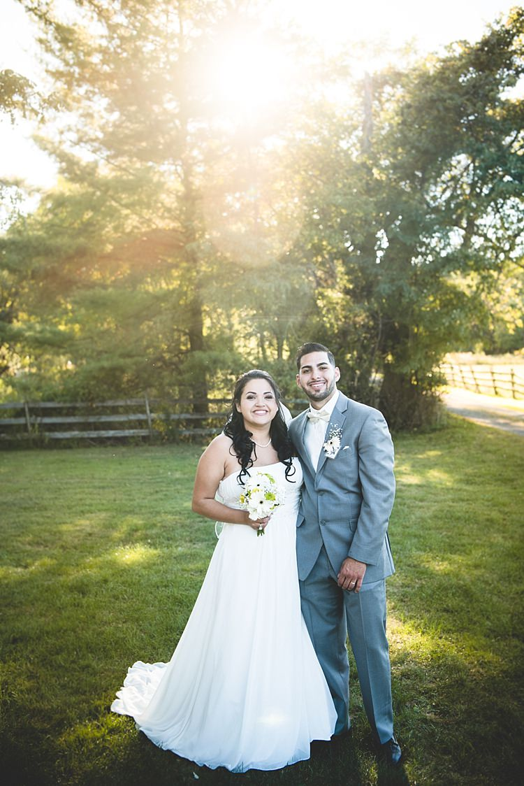 Bride Strapless Gown With Train Veil Bouquet White Yellow Gerberas Groom Grey Suit White Bowtie Sunshine Trees Alice in Wonderland Wedding Pennsylvania http://www.julieflorophotography.com/