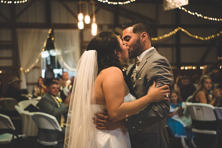 Reception Bride Strapless Gown With Train Veil Groom Grey Suit White Bowtie Dancing Kiss Guests Hanging Fairy Lights Tulle Alice in Wonderland Wedding Pennsylvania http://www.julieflorophotography.com/
