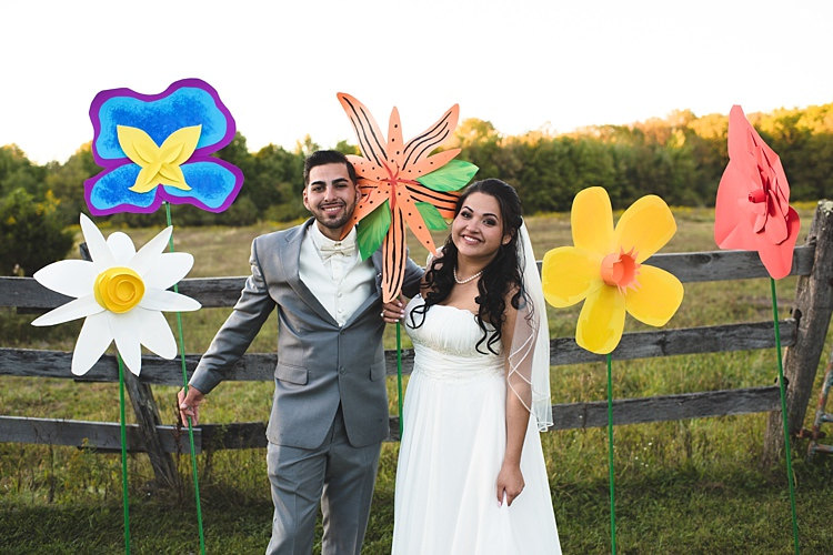 Bride Strapless Gown With Train Veil Groom Grey Suit White Bowtie Giant Colourful Paper Flowers Trees Wooden Fence Alice in Wonderland Wedding Pennsylvania http://www.julieflorophotography.com/