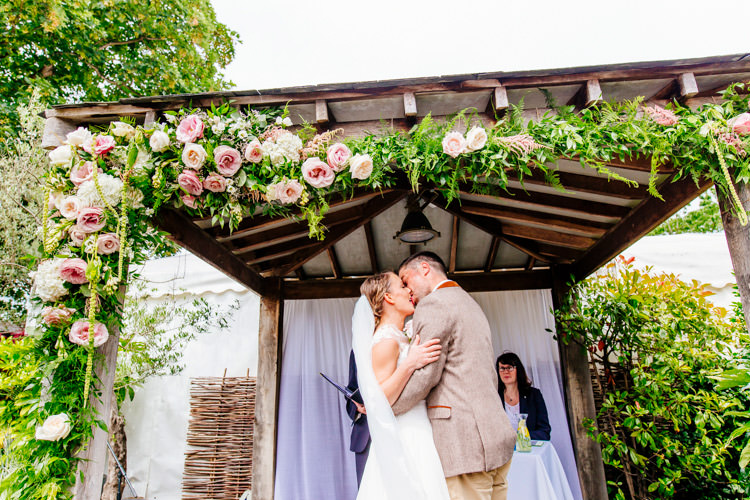 Flowers Arch Ceremony Arbour Gazebo Roses Fresh Relaxed Romantic Pink Green Pub Wedding http://www.els-photography.com/