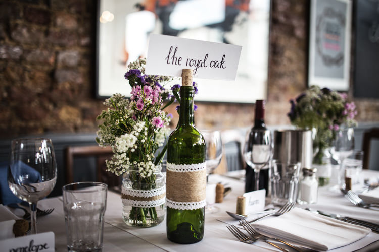 Wine Bottle Table Names Mismatched London Pub Wedding http://www.olliverphotography.com/