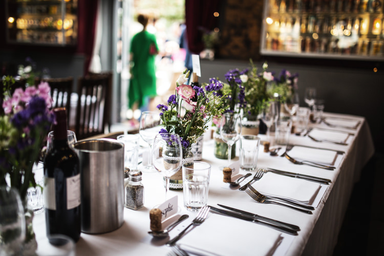 Table Flowers Bottles Jars Mismatched London Pub Wedding http://www.olliverphotography.com/