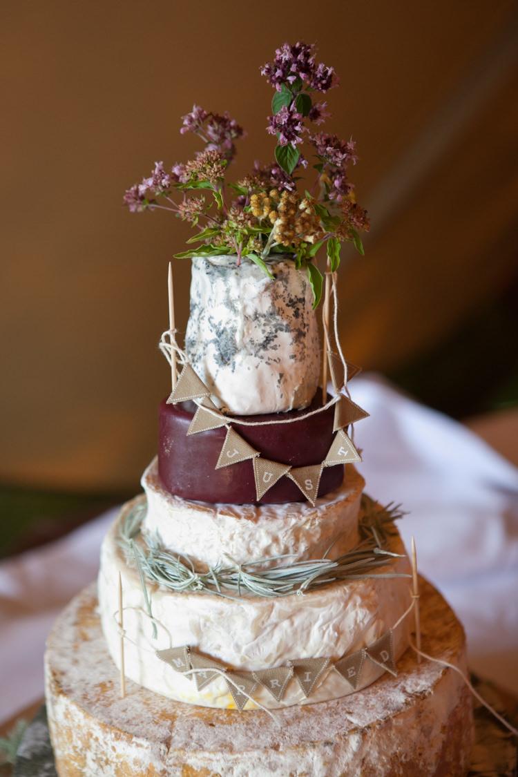 Cheese Tower Stack Cake Bunting Flowers Rustic Outdoor Rural Tipi Wedding http://emmastonerweddings.com/