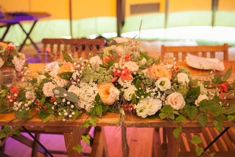 Top Table Flowers Orange Roses Rustic Outdoor Rural Tipi Wedding http://emmastonerweddings.com/