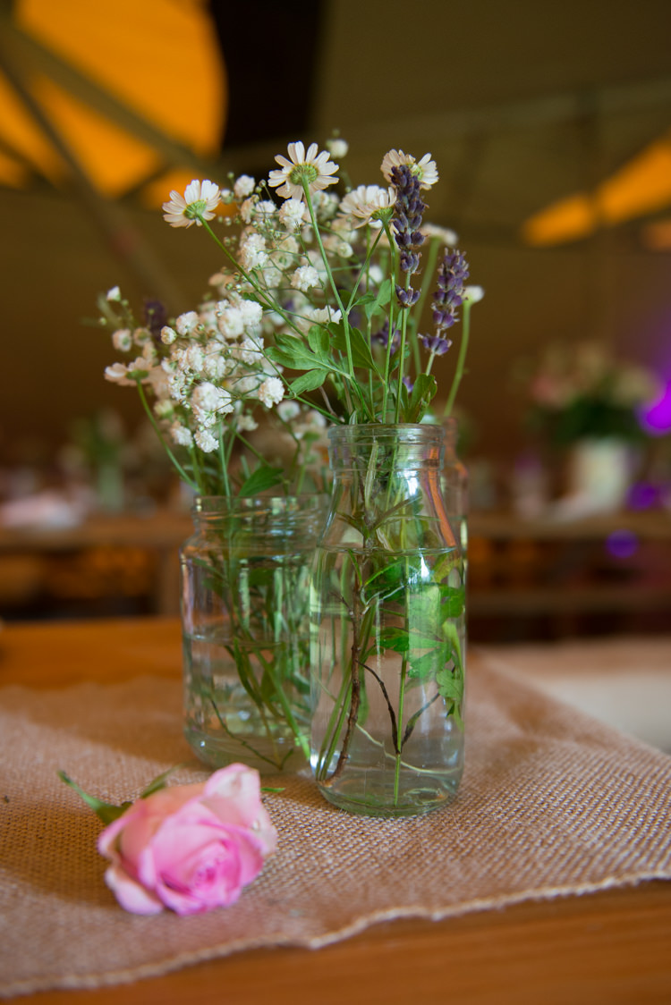 Wild Flowers Jar Bottles Rustic Outdoor Rural Tipi Wedding http://emmastonerweddings.com/