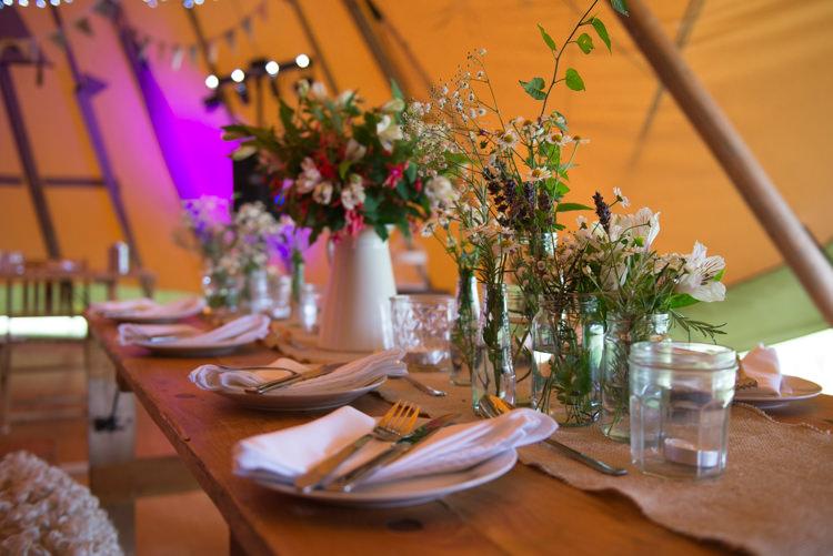Wild Flowers Jars Decor Rustic Outdoor Rural Tipi Wedding http://emmastonerweddings.com/
