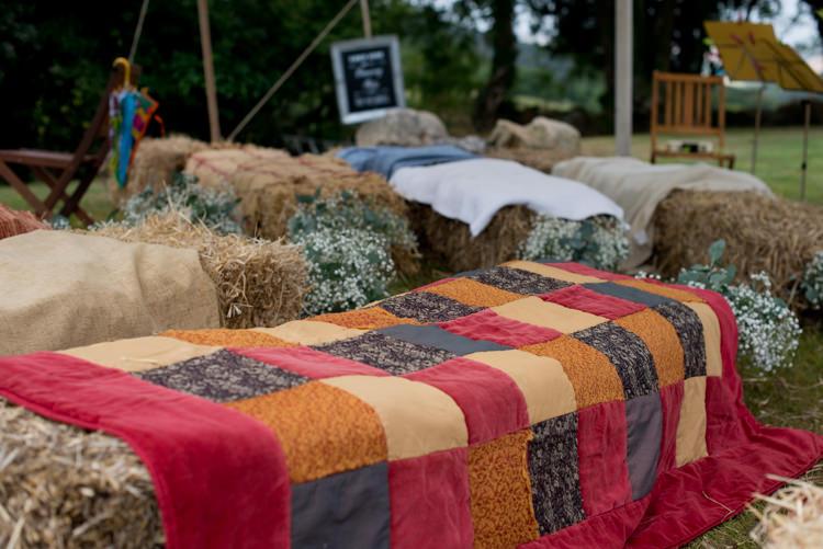 Hay Bale Seating Covers Flowers Rustic Outdoor Rural Tipi Wedding http://emmastonerweddings.com/