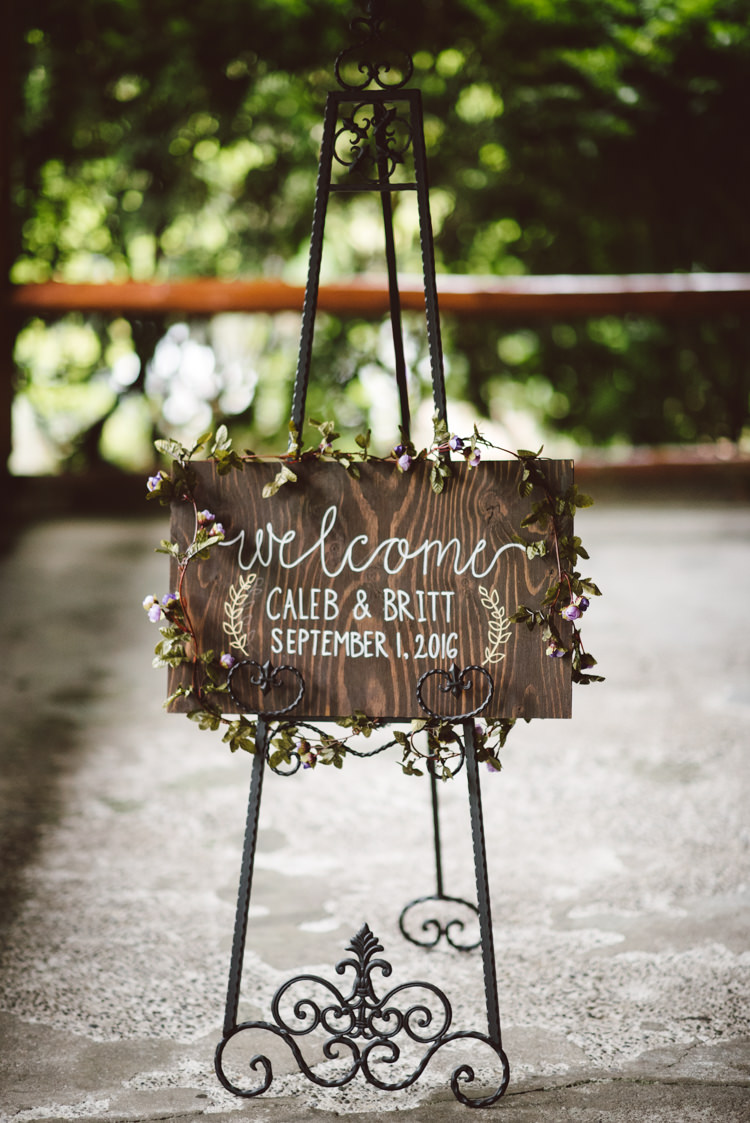 Wooden Welcome Sign White Calligraphy Floral Decoration Vintage Stand Magical Fairytale Forest Wedding Washington http://karissaroe.com/