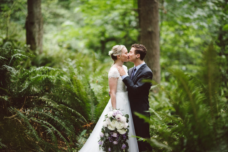 Bride Cap Sleeve Backless Tulle Bridal Gown Bouquet White Purple Chrysanthemum Roses Groom Charcoal Suit Patterned Purple Tie Kiss Greenery Trees Magical Fairytale Forest Wedding Washington http://karissaroe.com/