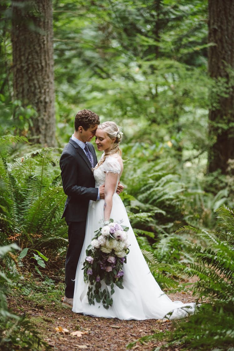 Bride Cap Sleeve Backless Tulle Bridal Gown Bouquet White Purple Chrysanthemum Roses Groom Charcoal Suit Patterned Purple Tie Toms Shoes Greenery Trees Magical Fairytale Forest Wedding Washington http://karissaroe.com/