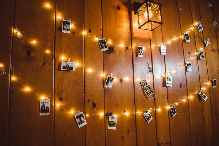 Reception Hanging Fairy Lights Polaroid Photos Pegs Wooden Wall Décor Magical Fairytale Forest Wedding Washington http://karissaroe.com/