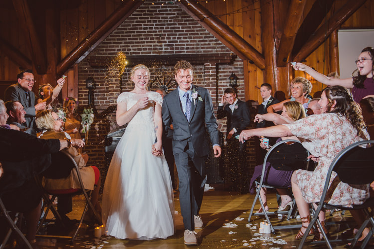 Wooden Hall Ceremony Bride Groom Glitter Exit Guests Celebration Magical Fairytale Forest Wedding Washington http://karissaroe.com/