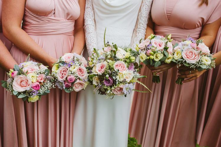 Bouquets Flowers Bride Bridal Bridesmaids Pink Purple Roses Pretty Festival Barn Countryside Wedding http://www.claretamim.co.uk/