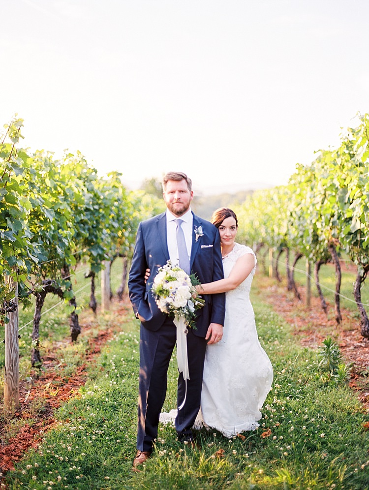 Bride Lace Cap Sleeve Bridal Gown Groom Navy Suit Purple Tie Bouquet Peonies Lavender Ribbon Sunset Vines Outdoor Spring Vineyard Wedding Tennessee http://www.juicebeatsphotography.com/