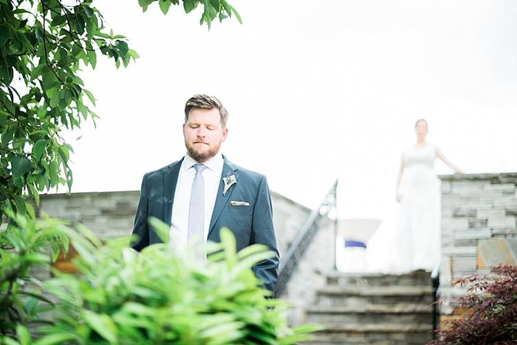 First Look Groom Navy Suit Purple Tie Bride Lace Cap Sleeve Bridal Gown Outdoor Spring Vineyard Wedding Tennessee http://www.juicebeatsphotography.com/