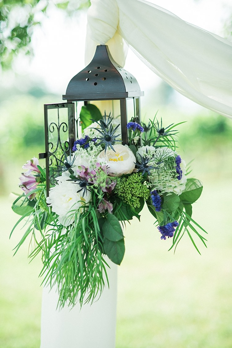 Hanging Décor White Fabric Metal Lantern Fresh Florals Peony Lavender Ranunculus Greenery Outdoor Spring Vineyard Wedding Tennessee http://www.juicebeatsphotography.com/