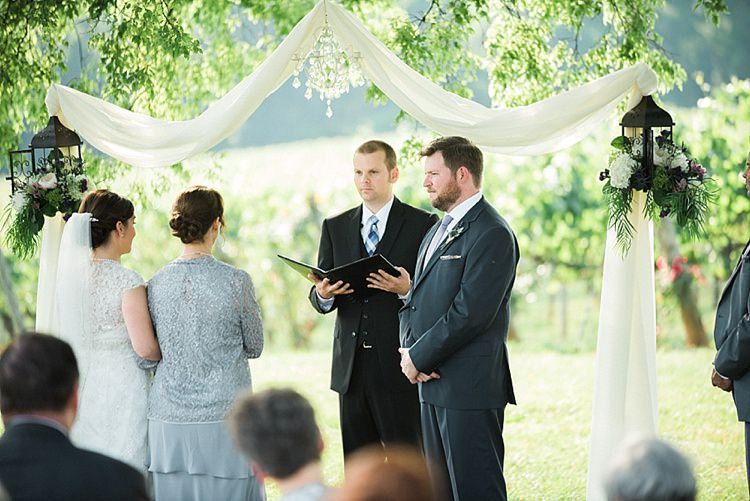 Outdoor Ceremony Bride Mother Groom Celebrant Hanging Décor Chandelier White Fabric Lanterns Fresh Florals Outdoor Spring Vineyard Wedding Tennessee http://www.juicebeatsphotography.com/