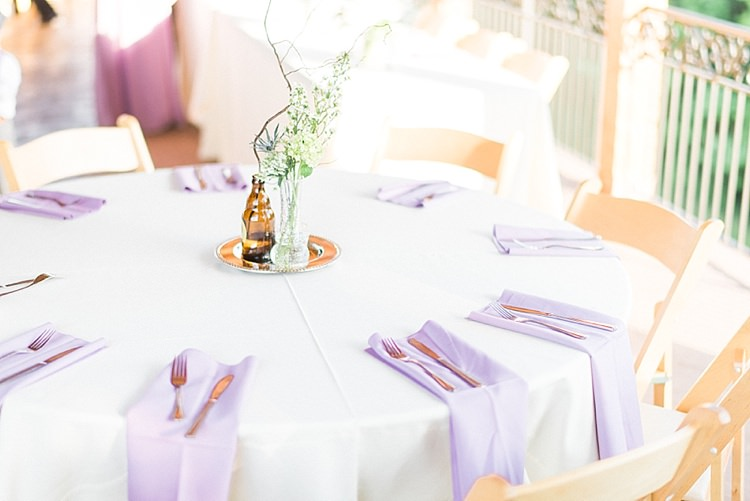 Reception Table Setting Lavender Serviettes Glass Vase Fresh Florals Brown Bottle Centrepiece Outdoor Spring Vineyard Wedding Tennessee http://www.juicebeatsphotography.com/