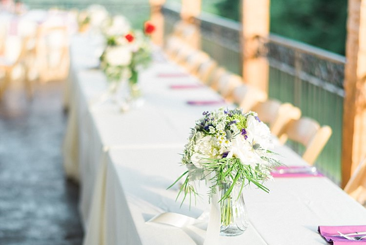 Reception Table Settings Lavender Serviettes Glass Vases Fresh Florals Ribbons Wooden Chairs Outdoor Spring Vineyard Wedding Tennessee http://www.juicebeatsphotography.com/