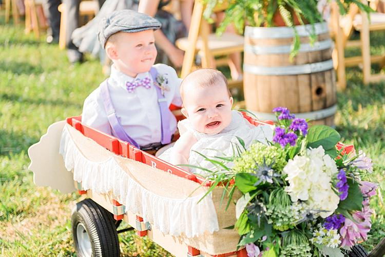 Outdoor Ceremony Ring Bearer Baby Decorated Cart Lace Fresh White Purple Florals Outdoor Spring Vineyard Wedding Tennessee http://www.juicebeatsphotography.com/