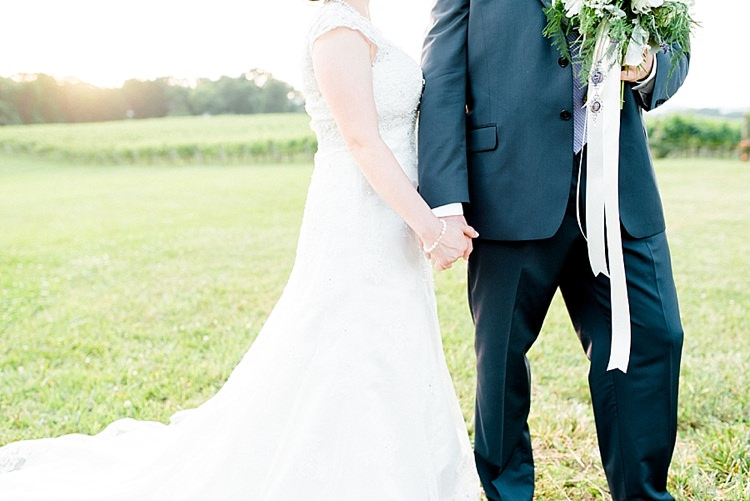 Bride Lace Cap Sleeve Bridal Gown Pearls Groom Navy Suit Purple Tie Bouquet Peonies Lavender Daises Ribbon Sunset Vines Outdoor Spring Vineyard Wedding Tennessee http://www.juicebeatsphotography.com/