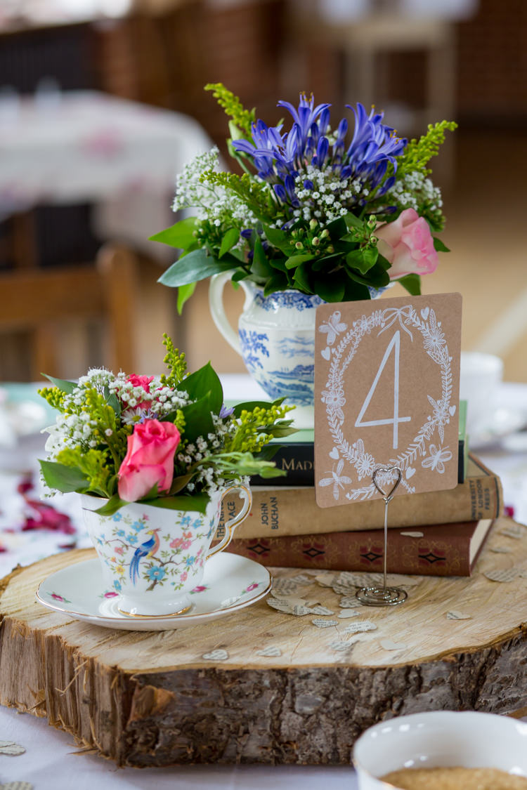 Tea Pot Tea Cup Flowers Log Centrepiece Decor Tables Name Paper 1950s Summer Fete Wedding http://www.mia-photography.com/