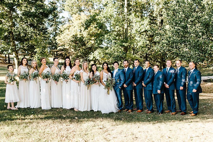 Bridal Party Bride Ivory Lace Tulle Wedding Gown Groom Navy Blue Suit Bridesmaids Groomsmen Bouquets Wild Florals Eucalyptus Outdoors Whimsical Boho Outdoor Wedding Alabama http://belightphotography.com/