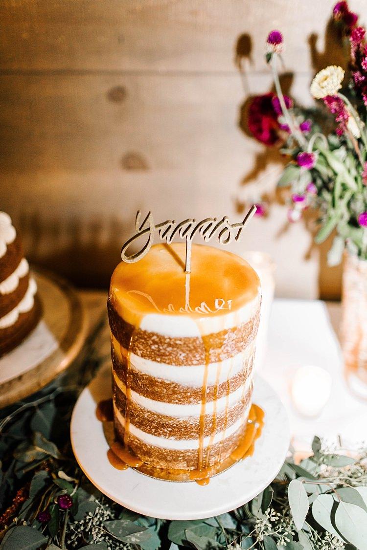 Reception Multilayered Wedding Cake Wooden Cake Topper Fresh Florals Eucalyptus Whimsical Boho Outdoor Wedding Alabama http://belightphotography.com/