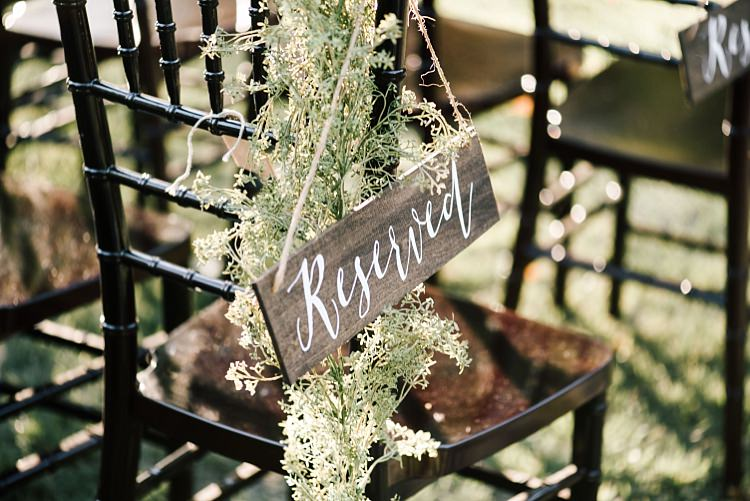 Outdoor Ceremony Seating Wooden DIY Reserved Sign White Calligraphy Fresh Wild Florals Wooden Chairs Whimsical Boho Outdoor Wedding Alabama http://belightphotography.com/