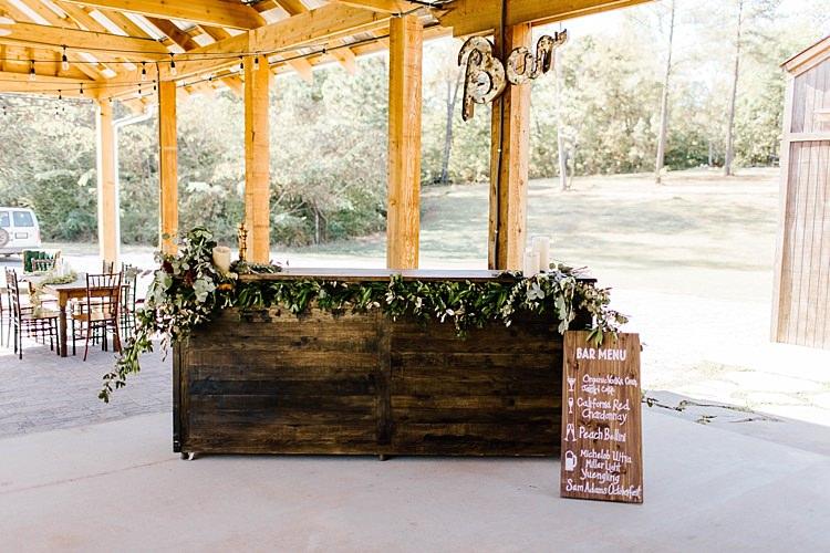 Reception Wooden Bar Fresh Wild Florals Eucalyptus Lit Bar Sign Wooden DIY Drinks Menu Sign White Calligraphy Barn Reception Whimsical Boho Outdoor Wedding Alabama http://belightphotography.com/