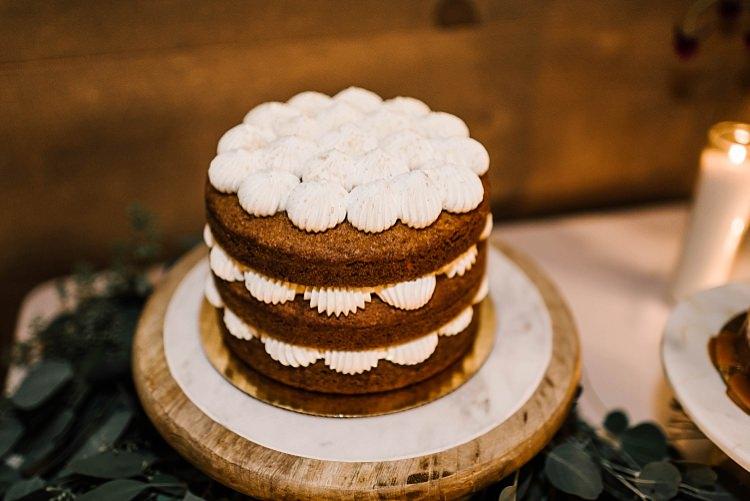 Reception Desserts Multilayered Cake Wooden Stand Fresh Eucalyptus Whimsical Boho Outdoor Wedding Alabama http://belightphotography.com/