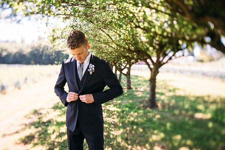 Groom Navy Blue Suit Vest Grey Tie Floral Button Hole Style Organic Farm Wedding Washington http://www.katiedayphotos.com/