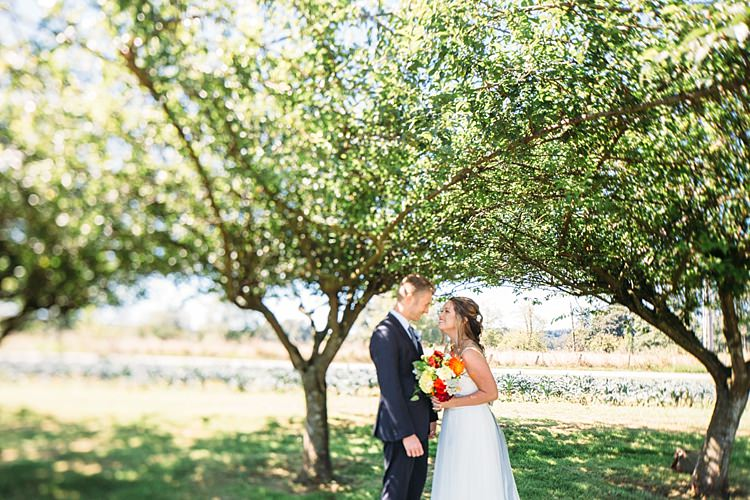 Bride Lace Tulle Bridal Gown Grey Sash Bright Orange Red Yellow Bouquet Groom Navy Blue Suit Trees Organic Farm Wedding Washington http://www.katiedayphotos.com/