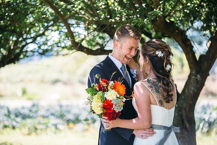 Bride Lace Tulle Bridal Gown Grey Sash Tattoo Bright Orange Red Yellow Bouquet Groom Navy Blue Suit Grey Tie Trees Organic Farm Wedding Washington http://www.katiedayphotos.com/